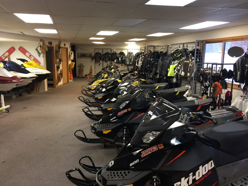 Seaberg motorsports rental snowmobiles lined up ski doo polaris yamaha arctic cat